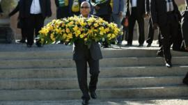 South African President Jacob Zuma lays a floral tribute at the Hector Pieterson memorial