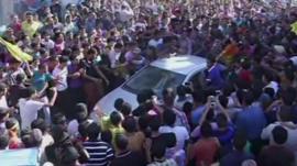 Thousands of fans surround a car carrying Arab Idol winner Mohammed Assaf