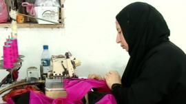 Woman at sewing machine