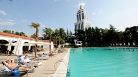 Sunbathers next to a pool at a luxury hotel in Batumi, Georgia