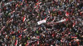 Anti-Mursi protesters carry a banner saying