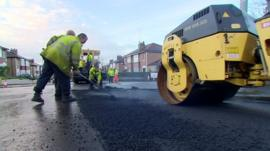 Council workers repairing road