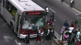 Protestors attack a bus in Manaus