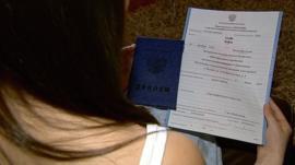 Hayley Stobo holds her certificate