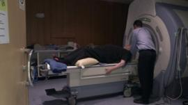 Ken Macdonald going into the MRI scanner