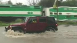 Vehicle driving through flood water