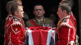 Royal Fusiliers carry the coffin of Fusilier Lee Rigby out of Bury Parish Church