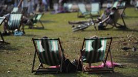 Sunbathers in Hyde Park, London