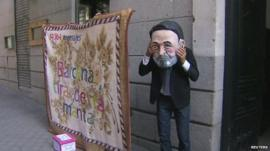 A Spanish protestor dressed as Mariano Rajoy