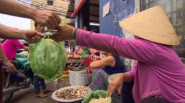 Woman selling lettuce in Vietnam