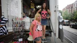 Katie Lubieski and Abby Kessler outside of their fashion truck