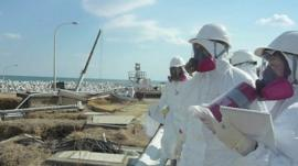 People in protective suits