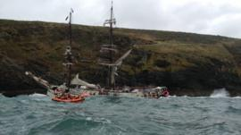 The Astrid tall ship and a lifeboat
