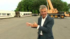 BBC reporter Tim Willcox looks at the industrial yard that will investigate what happened to the the train that crashed outside Santiago de Compostela in Spain.