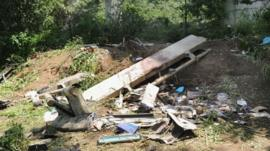 Debris lies on the ground after a coach plunged from a flyover on the A16 motorway between Monteforte Irpino and Baiano