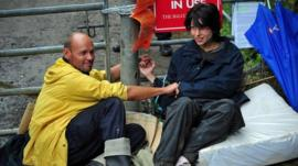 Two protesters with hands glued together