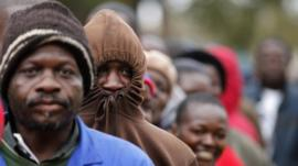 Zimbabweans wait to cast their vote outside Harare. Photo: 31 July 2013