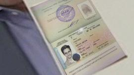 Anatoly Kucherena held up Snowden's passport to show journalists the asylum stamp granted by Russia