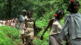 Women walk through threatened area