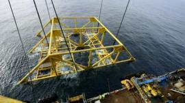 The platform frame is lowered into the sea