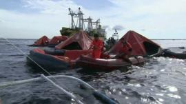 Lifeboats at scene of Philippines ferry disaster