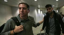 Glenn Greenwald (l) with his partner David Miranda in Rio de Janeiro's International Airport