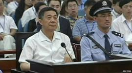 Bo Xilai (l) in court