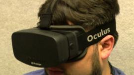 A man wearing an Oculus Rift headset