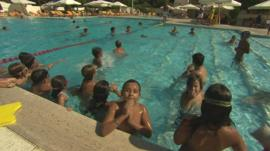 Children play in hotel pool