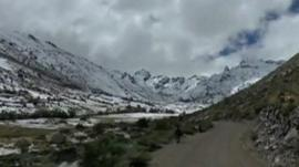 Snow covers mountains in Peru