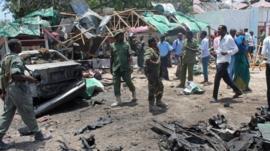 Somali soldiers gather near The Village restaurant following blast