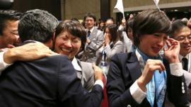 Members of Japan's delegation celebrate after Tokyo was awarded the 2020 Olympic Games