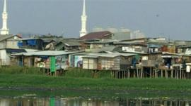 Slums on the edge of Jakarta's biggest dam.