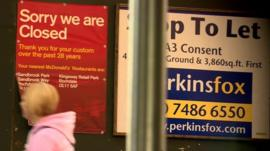 Poster notifying customers of store closure (l) a sign advertising an empty shop to-let (r)