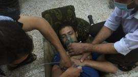 A man, affected by what activists say is nerve gas, breathes through an oxygen mask in the Damascus suburb of Jesreen on August 21.