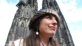 Helena Barcos beside Cologne's cathedral