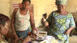 Women save money at a local Benin credit association