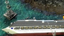 Graphic shows Costa Concordia lying on its side