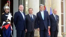 French President Francois Hollande (2nd L) welcomes British Foreign Secretary William Hague (L), US Secretary of State John Kerry (2nd R) and French Foreign minister Laurent Fabius at Elysee Palace on September 16, 2013 in Paris, France.
