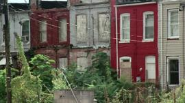 Boarded-up houses in Baltimore