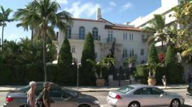 People walking past Gianni Versace's former home