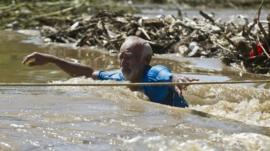 Man wades through floodwaters