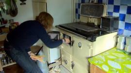 A woman lighting a cooker