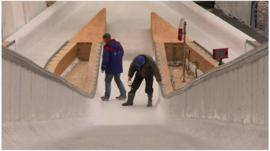 Men working on a ski jumping ramp