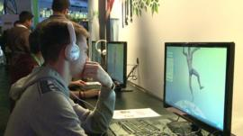 A man on a computer at the UK's biggest international video games show
