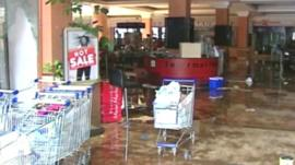 Trolleys inside damaged shopping mall