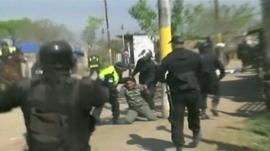 Police officers subdue a man