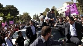 Iranian President Hassan Rouhani waves to supporters in Tehran