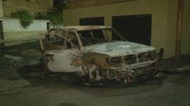 Burned car outside Russian embassy after Tripoli attack