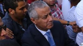 Libyan Prime Minister Ali Zeidan (C) arrives at the government headquarters in Tripoli shortly after he was freed